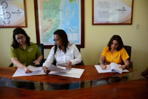 Mrs. Amanda Acosta, Executive Director, Belize Audubon Society, along with Ms. Lejia Melanie Gideon, General Manager, Enterprise & Innovation Division and Mrs. Nilda Riverol signing the MOU.