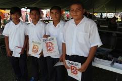 Students holding copy of Invest Belize Magazine