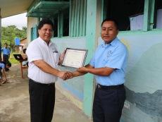 receiving-a-certificate-of-appreciation-on-behalf-of-beltraide-from-santa-cruz-rc-school-principal